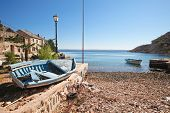 stock photo of yugoslavia  - Old wooden fishing boat abandoned in little village along the coast in Croatia - JPG