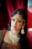 pic of traditional attire  - Image of a beautiful Indian bride traditionally attired - JPG