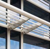 stock photo of louvers  - Architectural detail of a modern building featuring energy efficient louver system - JPG