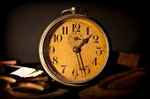 stock photo of movable  - Alarm clock ancd movable types on a dark background - JPG