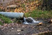 stock photo of water pollution  - water flowing from drain pipe - JPG