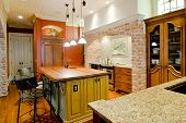 picture of armoire  - opulent kitchen with island and custom cabinets - JPG