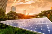 Ecological energy renewable solar panel plant with urban landscape landmarks poster