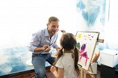 Happy Fathers Day.funny Portrait Of Smiling Father And Her Daughter Painting With Watercolor On Eas poster