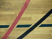 Black Lines In Hall Playground. Worn Out Wooden Floor. Wooden Floor Basketball Court With Light Effe poster