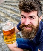 Guy Having Rest With Draught Beer. Hipster On Cheerful Smiling Face Drinks Beer Outdoor. Celebration poster