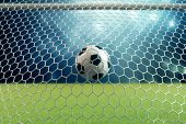 3d Rendering Soccer Ball In Goal. Soccer Ball In Net With Spotlight And Stadium Light Background, Su poster
