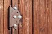 Architecture Background With Natural Vintage Wooden Door And Old Metal Door Hinge. Closeup Of Archit poster