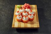 Philadelphia Sushi Roll - Maki Sushi with Philadelphia Cheese inside. Salmon outside. Topped with Sa poster