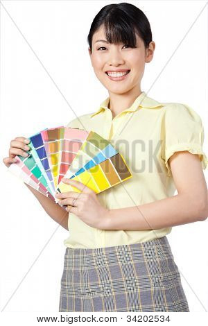 Happy young Asian woman showing color chart isolated on white background.
