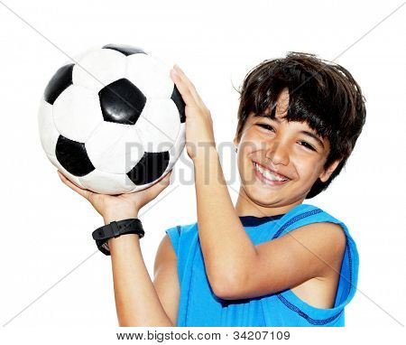 Cute boy playing football, happy child, young male teen goalkeeper enjoying sport game, holding ball, isolated portrait of a preteen smiling and having fun, kids activities, little footballer