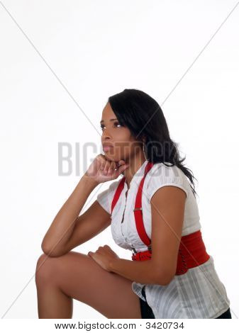 Young Black Woman With Elbow On Knee