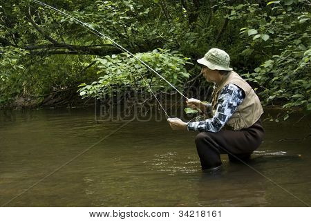 Fisherman In Waders