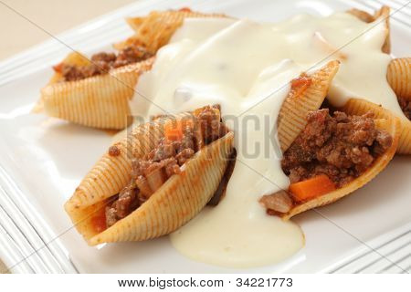 Pasta shells filled with a bolognaise-type meat sauce and topped with a cheesy bechamel.