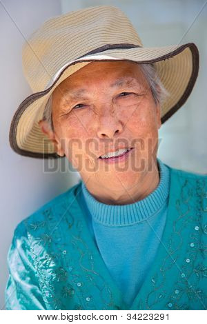 Happy Chinese Senior Woman Outdoor Portrait Wearing Straw Hat