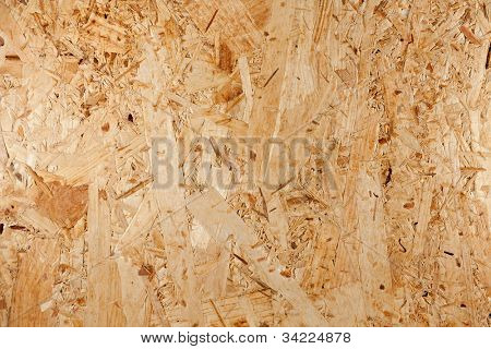 Closeup of oriented strand board,construction material made of recycled wood