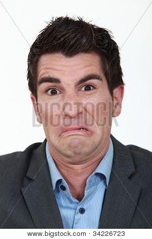 Portrait of a man grimacing