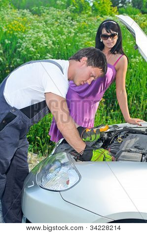 Mechanic Measures Lead-acid Battery Charge.
