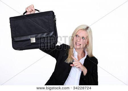 businesswoman holding a brief case