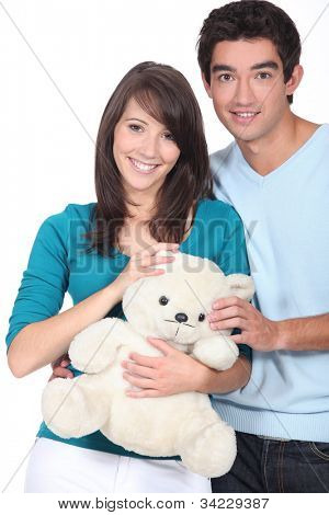 Young couple with a teddy bear