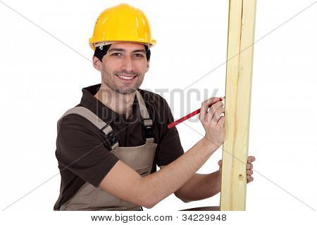 craftsman measuring a wooden piece