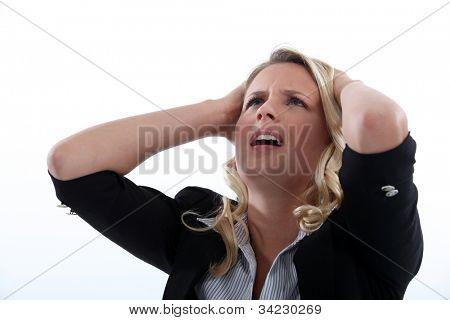 Horrified blond businesswoman