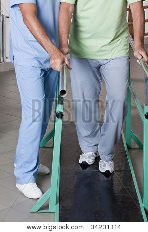 Senior man having ambulatory therapy with his therapist.