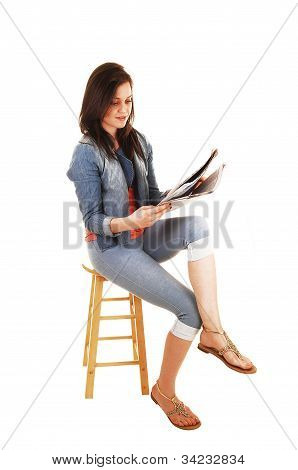 Girl Reading Newspaper.