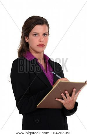 A businesswoman taking notes.
