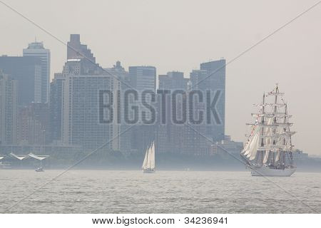 HOBOKEN, NJ - MAY 23: The tall ship Cisne Branco (Brazil) sails on the Hudson River past Manhattan during the Parade of Sail on May 23, 2012 in Hoboken, NJ. The parade is the start of Fleet Week.