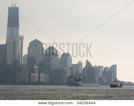 HOBOKEN, NJ - MAY 23: The RFA Argus A135 (UK) goes past the World Trade Center in Lower Manhattan during the Parade of Sails on May 23, 2012 in Hoboken, NJ. The parade marks the start of Fleet Week.