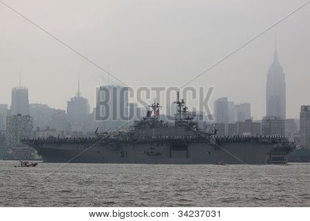 HOBOKEN, NJ - MAY 23: The USS Wasp (LHD 1) on the Hudson River with the Manhattan in the background during the Parade of Sails on May 23, 2012 in Hoboken, NJ. The parade marks the start of Fleet Week.