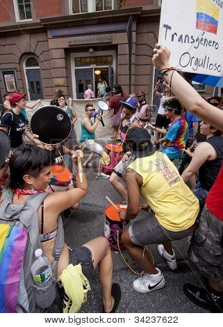 NEW YORK - JUNE 22: Supporters play homemade drums and dance outside of the LGBT Community Center during the rally on the 8th Annual Trans Day of Action on June 22, 2012 in New York City.