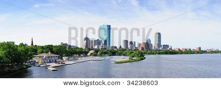 Boston back bay panorama with sailing boat and urban building city skyline in the morning.