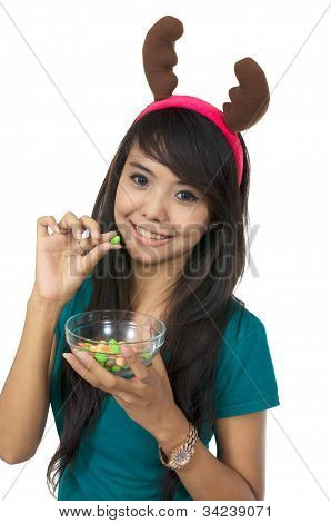 Santa Woman Eating Candy