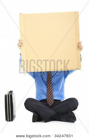 Businessman holding the blank cardboard
