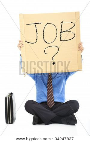 Businessman holding the text looking for a job