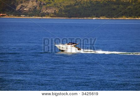 Speed-Boat Over Blue Sea