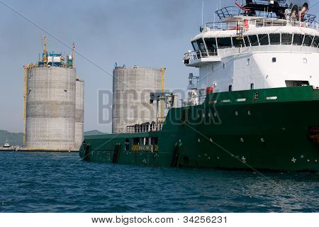 Ocean tug towing the base oil drilling platform. Sea Japan. Russian coast.