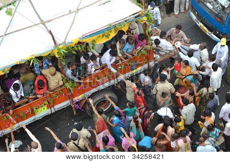 Devotees Offering Sweets To Crowd On Streets