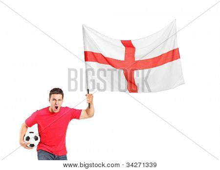 An euphoric fan holding a soccer ball and English flag isolated on white background