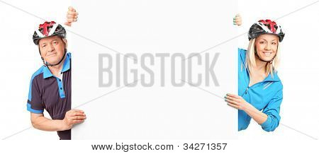 A man and female bicyclist holding a white panel isolated on white background