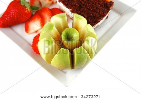 cream cake and raw fruits on plate
