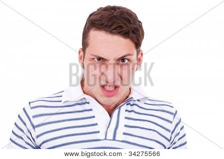 angry young casual man making a furious face on white background