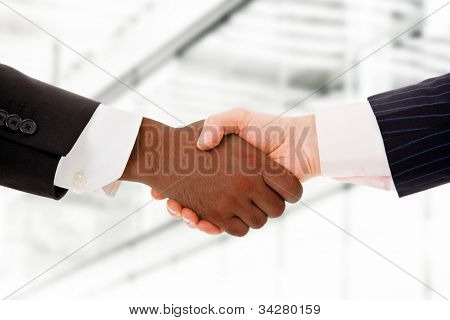 Business team shaking hands while in their office