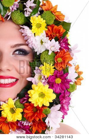 Beautiful woman�¢�?�?s face with  flower wreath around it