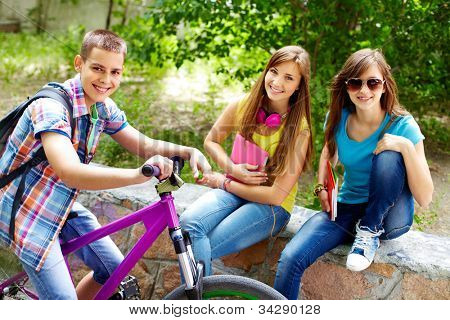 Guy on the bike stopping beside two beautiful girls
