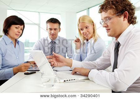 Business people looking at the screen of the laptop working at the office