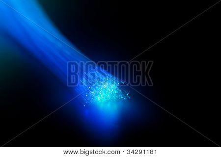 Tip of blue glowing bundle of fiber optics