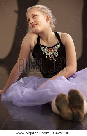 Carefree Ballet Student Sitting